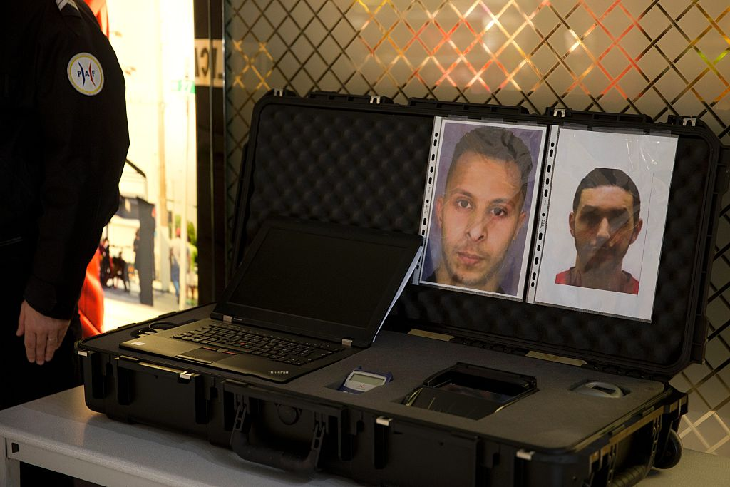 A picture taken on December 3, 2015 at the Roissy-Charles-de-Gaulle airport in Roissy-en-France, outside Paris shows the wanted notice of terrorist Salah Abdeslam (L) and Mohamed Abrini.  / AFP / KENZO TRIBOUILLARD        (Photo credit should read KENZO TRIBOUILLARD/AFP/Getty Images)