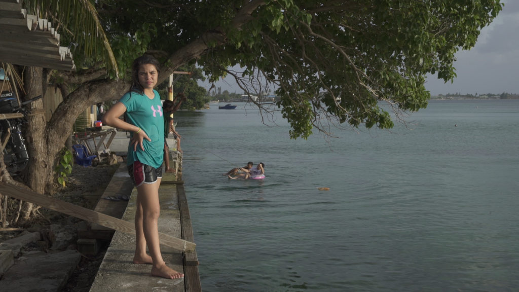 Faith Debrum, 12, is pictured near her home on the Marshall Islands. The island nation is part of an international coalition fighting to keep global temperatures from rising above 1.5 degrees Celsius.