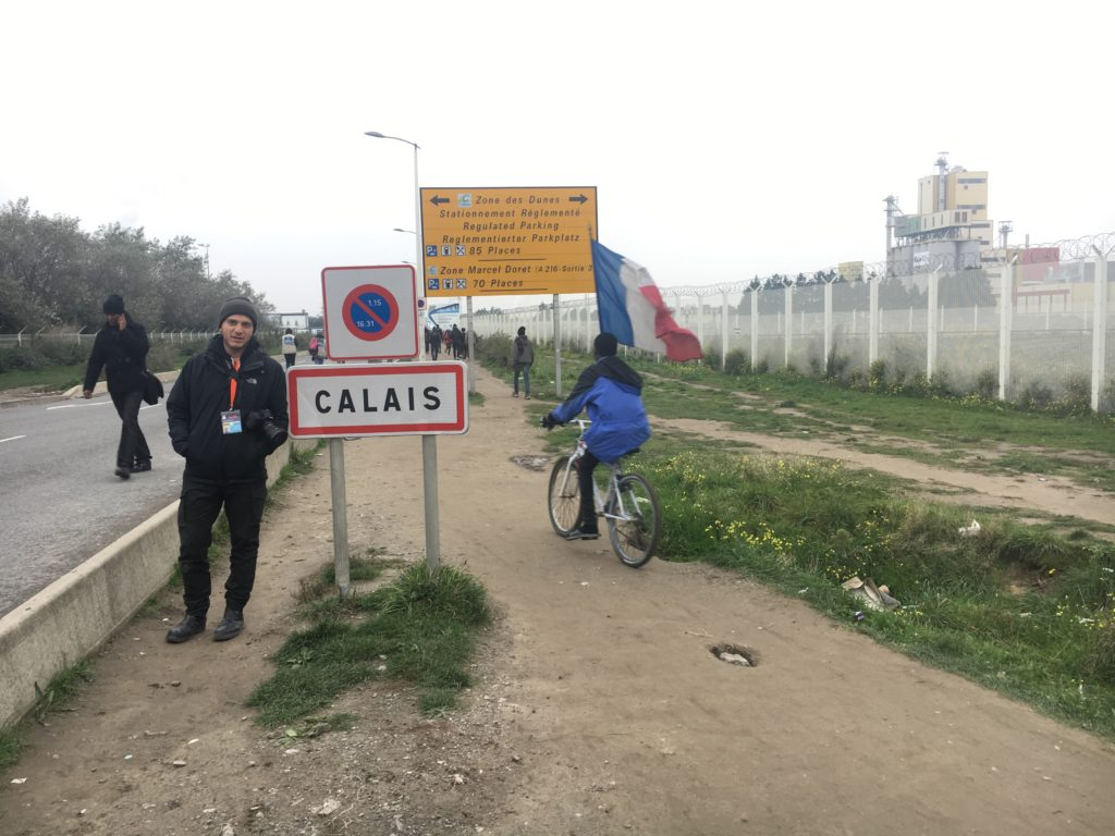 "In 2015, Syrian refugee Hassan Akkad spent two months stranded in ""The Jungle,"" the notorious migrant camp in Calais. In the fall of 2016, he returned to Calais -- but this time, he had gained asylum in the U.K., and a press pass."