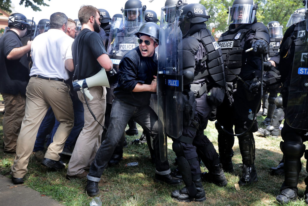 "White nationalists, neo-Nazis and members of the ""alt-right"" clash with police as they are forced out of Emancipation Park after the ""Unite the Right"" rally was declared an unlawful gathering August 12, 2017 in Charlottesville, Virginia."