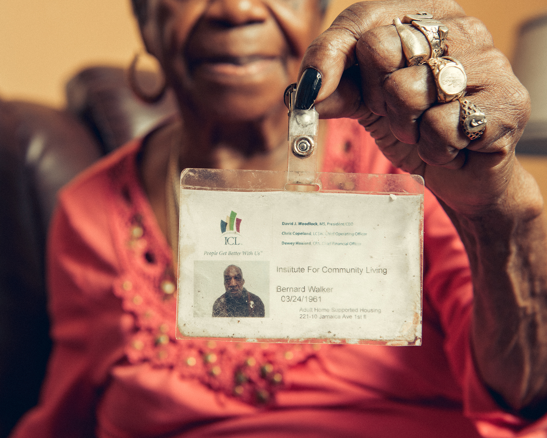 Rosetta Walker, 83, holds up an ID of her son, Bernard Walker, who was found dead in January 2016.