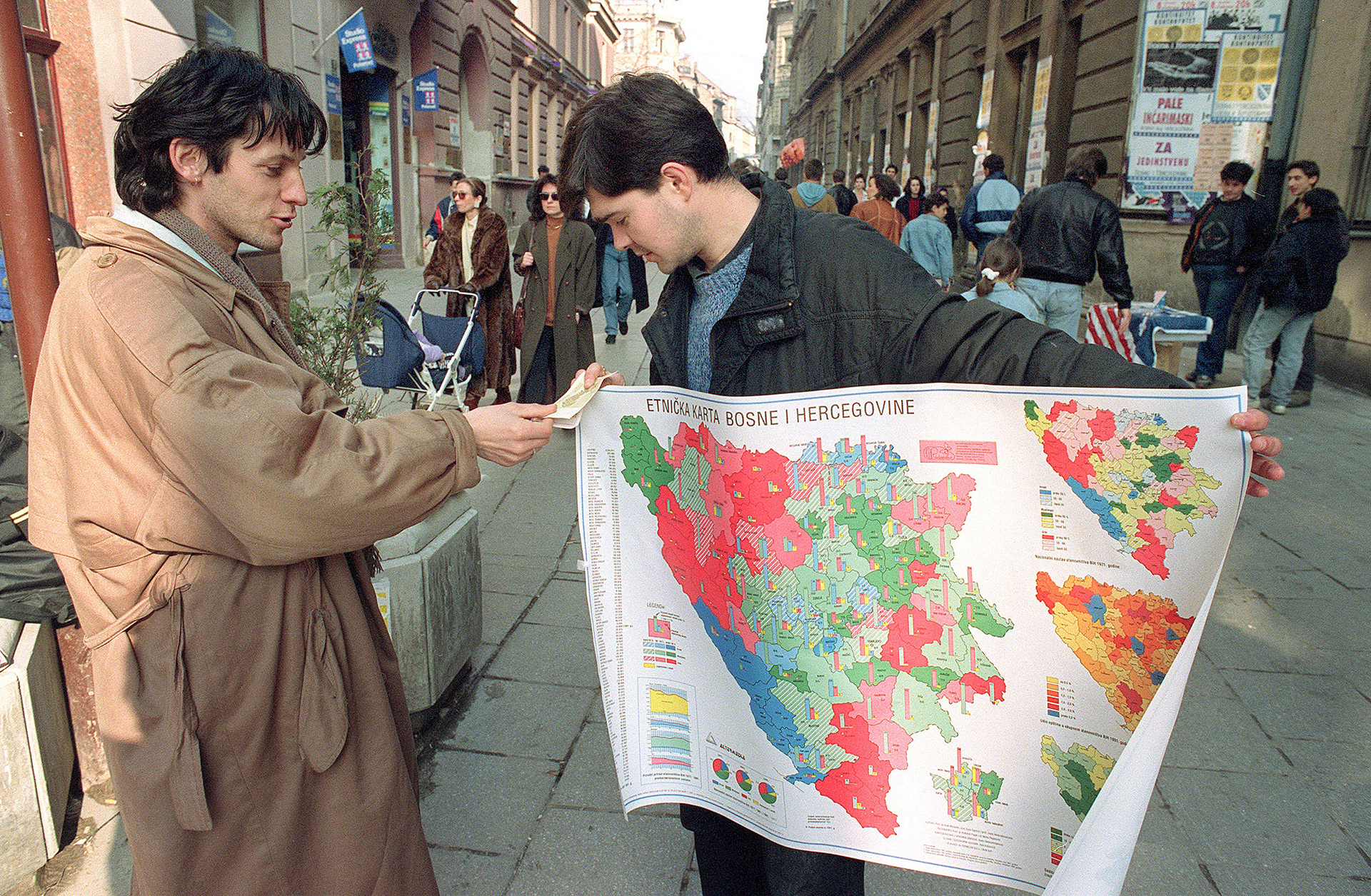 A street seller holds an ethnic distribution mag of Bosnia-Hercegovina as he talks to a fellow Bosnian in a Sarajevo shopping street 01 March 1992 while Bosnia-Hercegovina opened a second day of voting on independence. The state is the ethnic most varied in former Yugoslavia with Moslem Slavs, Croats and Serbs living together. AFP PHOTO MLADEN ANTONOV         (Photo credit should read MLADEN ANTONOV/AFP/Getty Images)