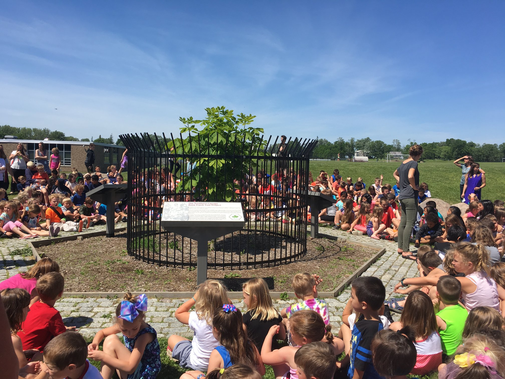 Children in Cayuga, New York, celebrate Anne Frank's 89th birthday in 2018 around Annie.