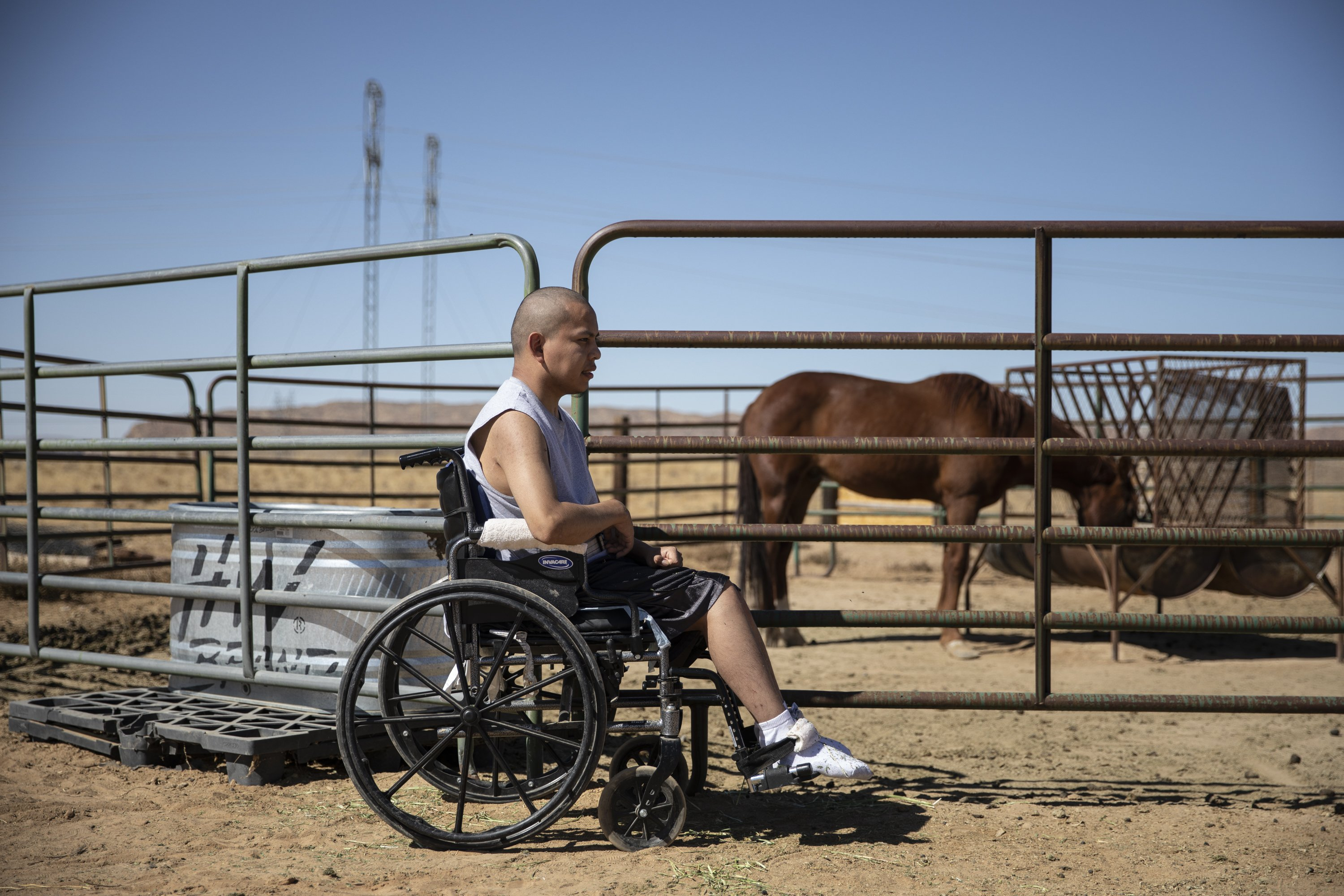 Lydell Begay sits beside the horse corral at his home in Fruitland, NM on October 14, 2019.