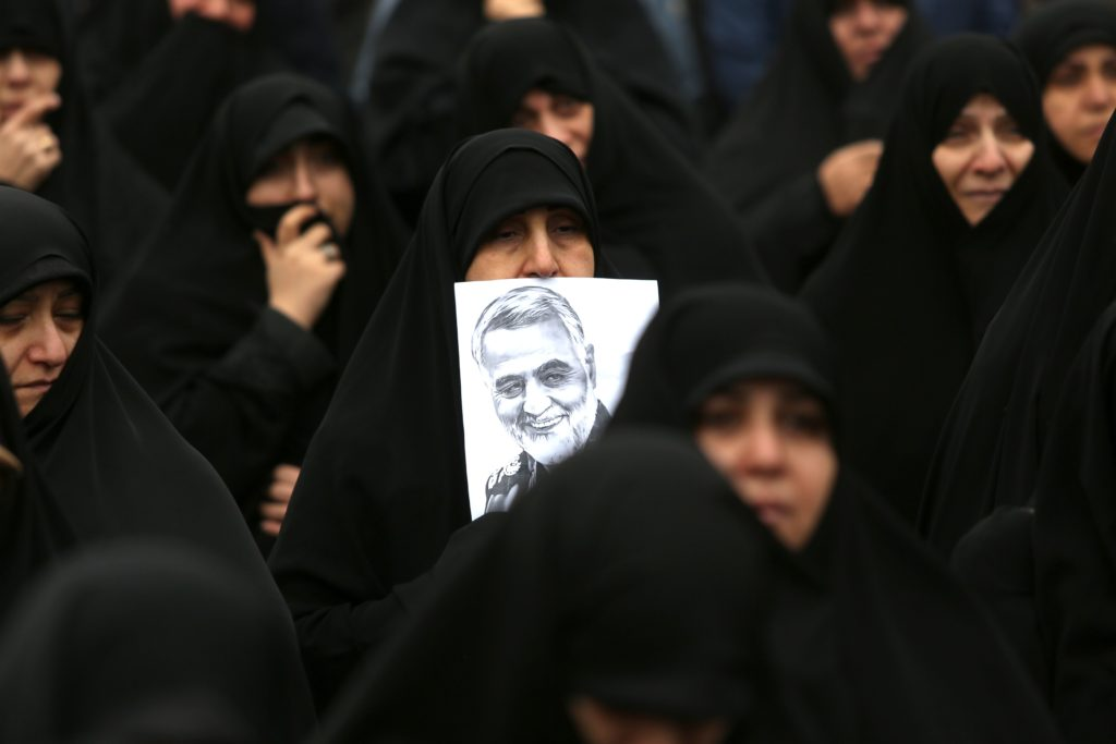 Black-clad Iranian women react as they take part in an anti-US rally to protest the killings of Iranian military commander Qasem Soleimani and Iraqi paramilitary chief Abu Mahdi al-Muhandis in Tehran on January 4, 2020.