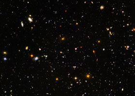 The Hubble Deep Field, a colorful mosaic of nearly 10,000 galaxies.