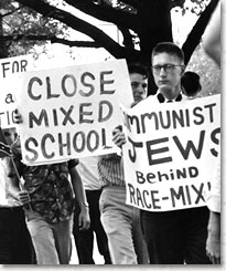 Photo of white students protesting school integration.