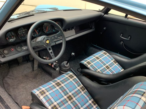small resolution of the main features of the interior include shell bucket seats with tartan inserts along with a custom finished leather wrapped dash