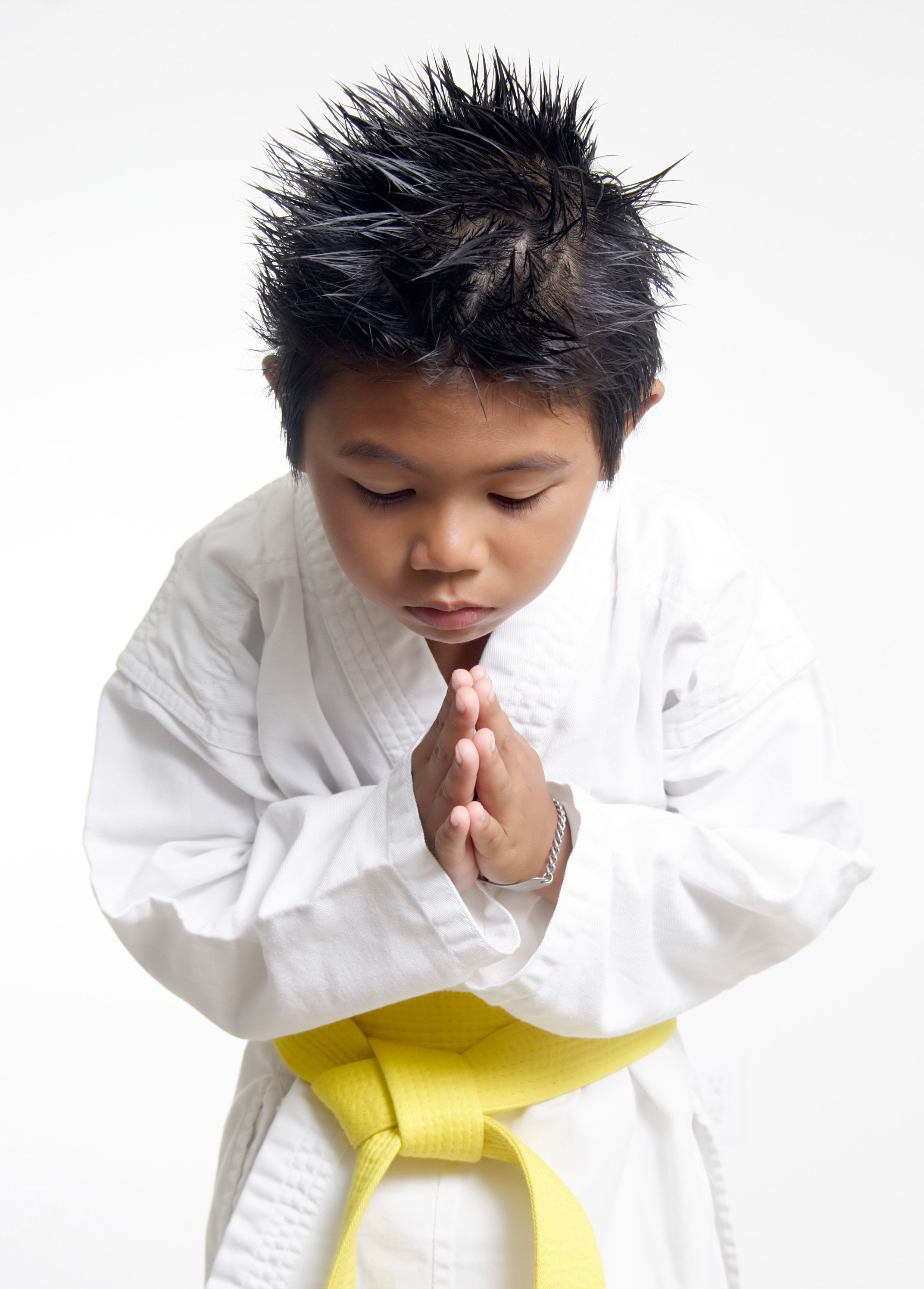 Karate boy bowing showing respect