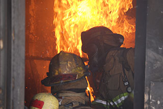 Firefighters training on a live fire