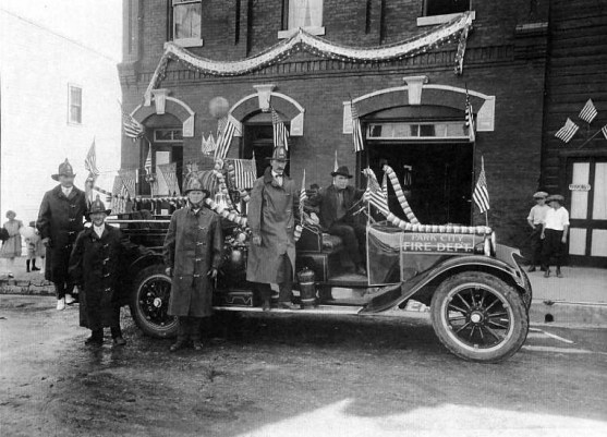 ca.1922-1924, firemen stand with truck decorated for parade, William Berry at the wheel, William A. Gidley standing on the fender. Photo courtesy of the Utah State Historical Society.