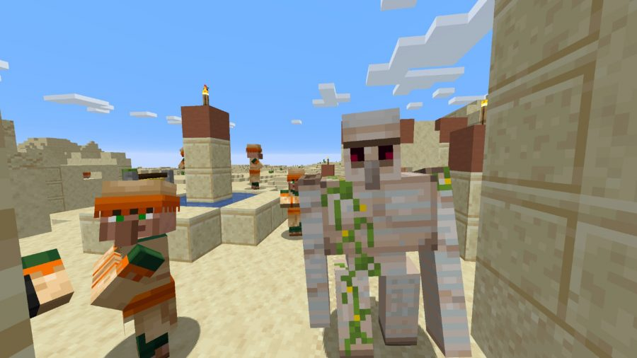 Minecraft village in the desert with an iron golem and villager