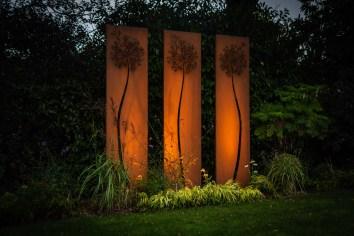 Corten sculpture and lighting design in Ashtead garden