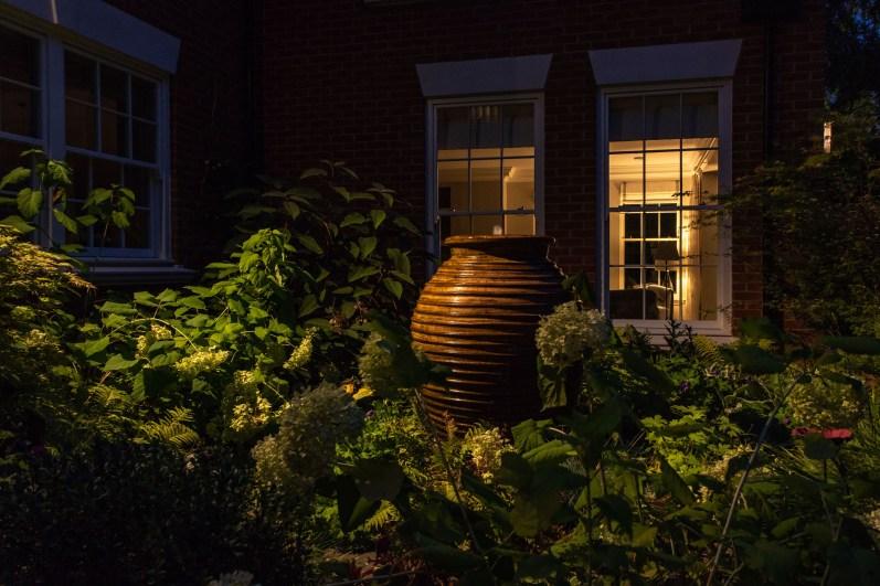 Lighting design and water feature in Surrey Garden
