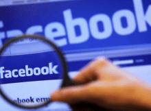 in questa immagine è presente la pagina di login facebook vista attraverso una lente di ingrandimento.
