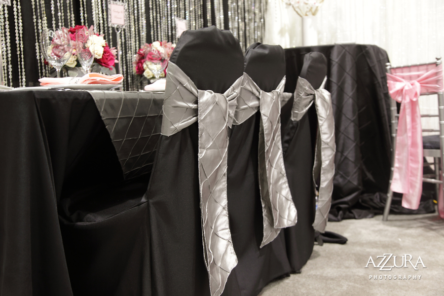 sashes for wedding chair covers queen anne dining platinum designs linens rentals greater silver pintuck sash tied over black banquet