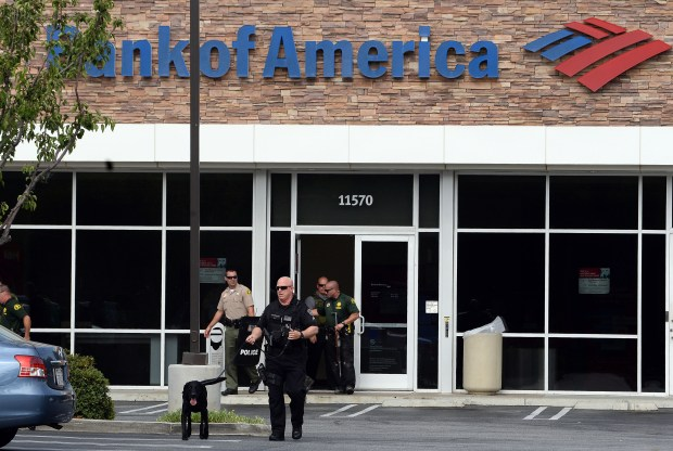 Rancho Cucamonga police and San Bernardino County Sheriff deputies exit the Bank of America on Fourth Street in Rancho Cucamonga Thursday afternoon July 6, 2017 following a possible bomb threat. The bank was cleared at approximately 4:45 p.m. and no device was found. (Will Lester-Inland Valley Daily Bulletin/SCNG)