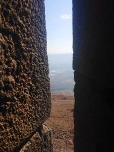 A view of Jordan through an arrowslit at the Crusader castle of Belvoir, Israel.