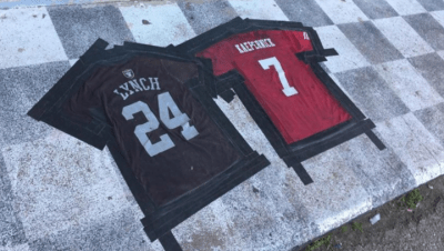 """Jerseys spelling out 'Lynch Kaepernick"""" are taped down as doormats at SNAFU Bar in Missouri"""