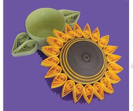 Quilled paper sunflower-shaped trinket box with green base
