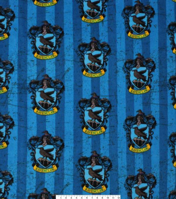 fabric with Ravenclaw crest on a blue background