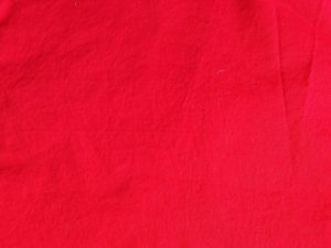 red solid-colored fabric