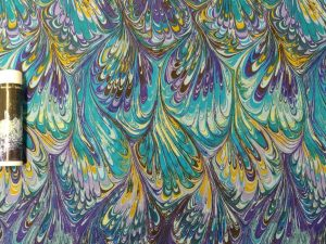 fabric with teal, purple, and yellow marbling