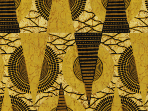 African-inspired fabric with triangles and circles in gold and brown