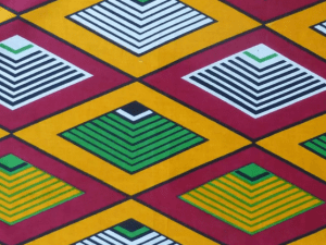 African geometric diamond pattern in yellow, burgundy. white, and green