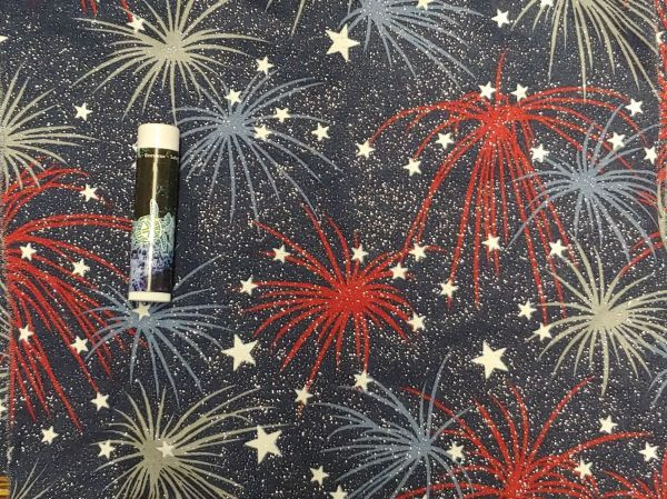 red, white, and glitter fireworks on a dark blue background