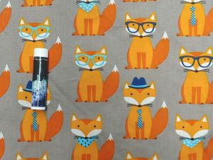 orange foxes with glasses and hats on grey