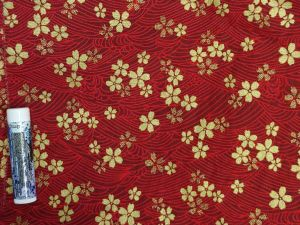 gold cherry blossoms over red stylized waves