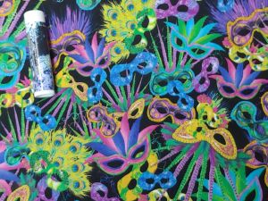 mardi gras masks in green, purple, and blue