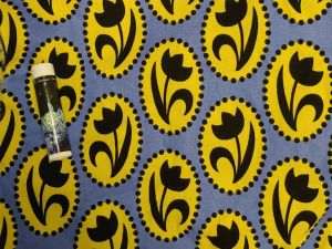 black tulip silhouettes in yellow ovals on a blue background