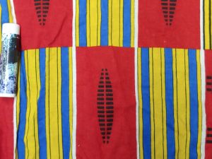 alternating pattern of red rectangle with black design and blue and yellow striped rectangle