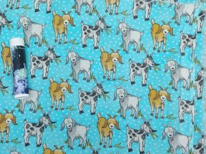 brown and gray goats on a light blue background