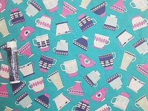 pink, purple, and white teacups on a teal background