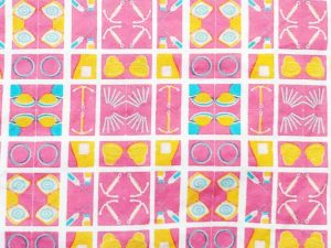 quilt pattern with a pink background and drawings of contraceptives/birth control methods in yellow, blue, and white