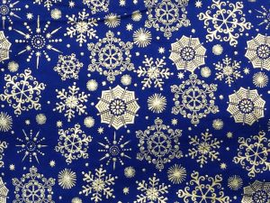 silver snowflakes of varied design on a royal blue background