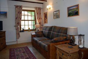Corner Cottage, Stoney Middleton - Living room with sofa bed