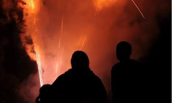 people watching a fireworks display