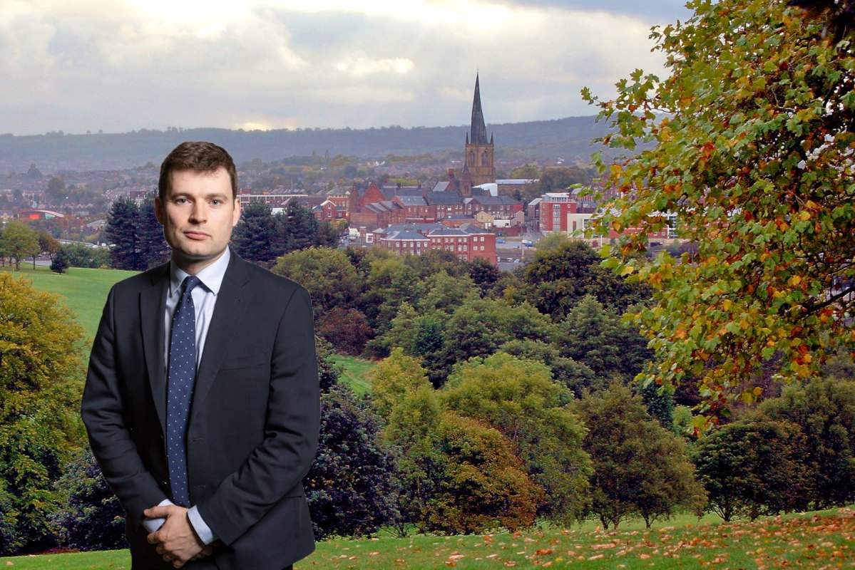 Robert Largan's parliamentary portrait superimposed on the skyline of Chesterfield with its famous crooked church spire.