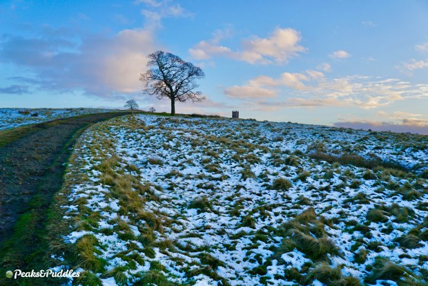 Climbing to the Cage at Lyme Park, Disley in the snow