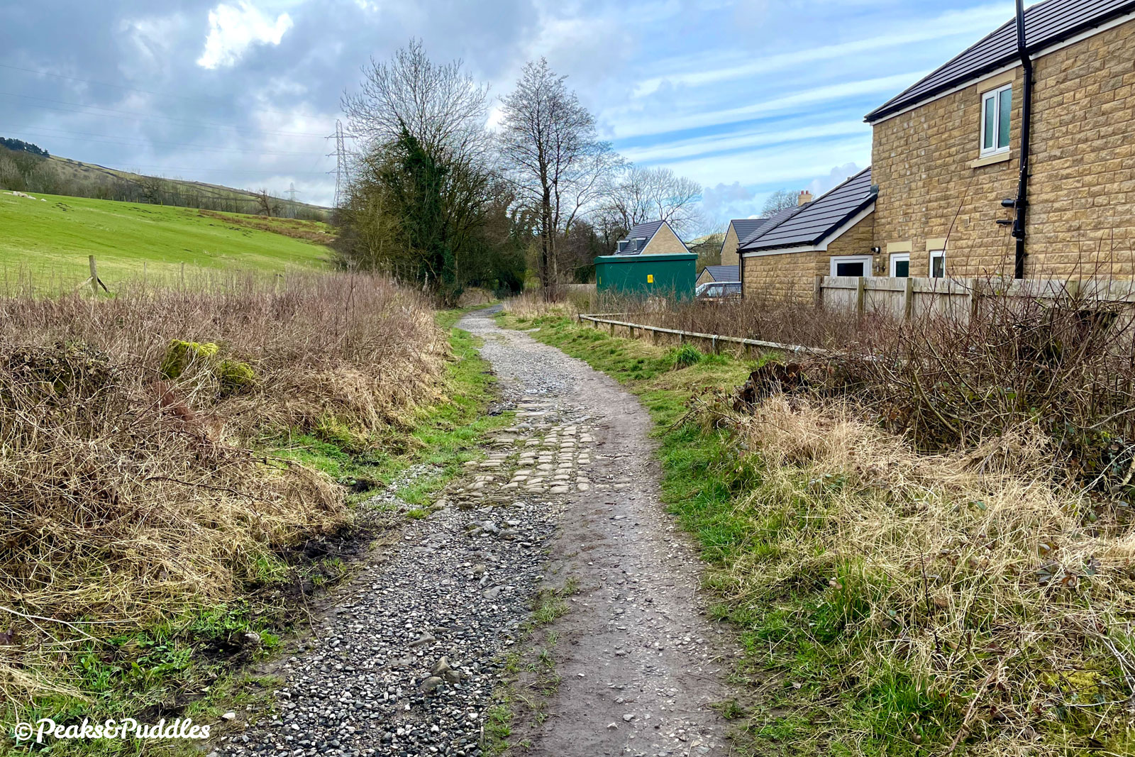 Looking back towards Whitehough alongside Forge Manor housing development. The cobbles here are nothing on what's to come!