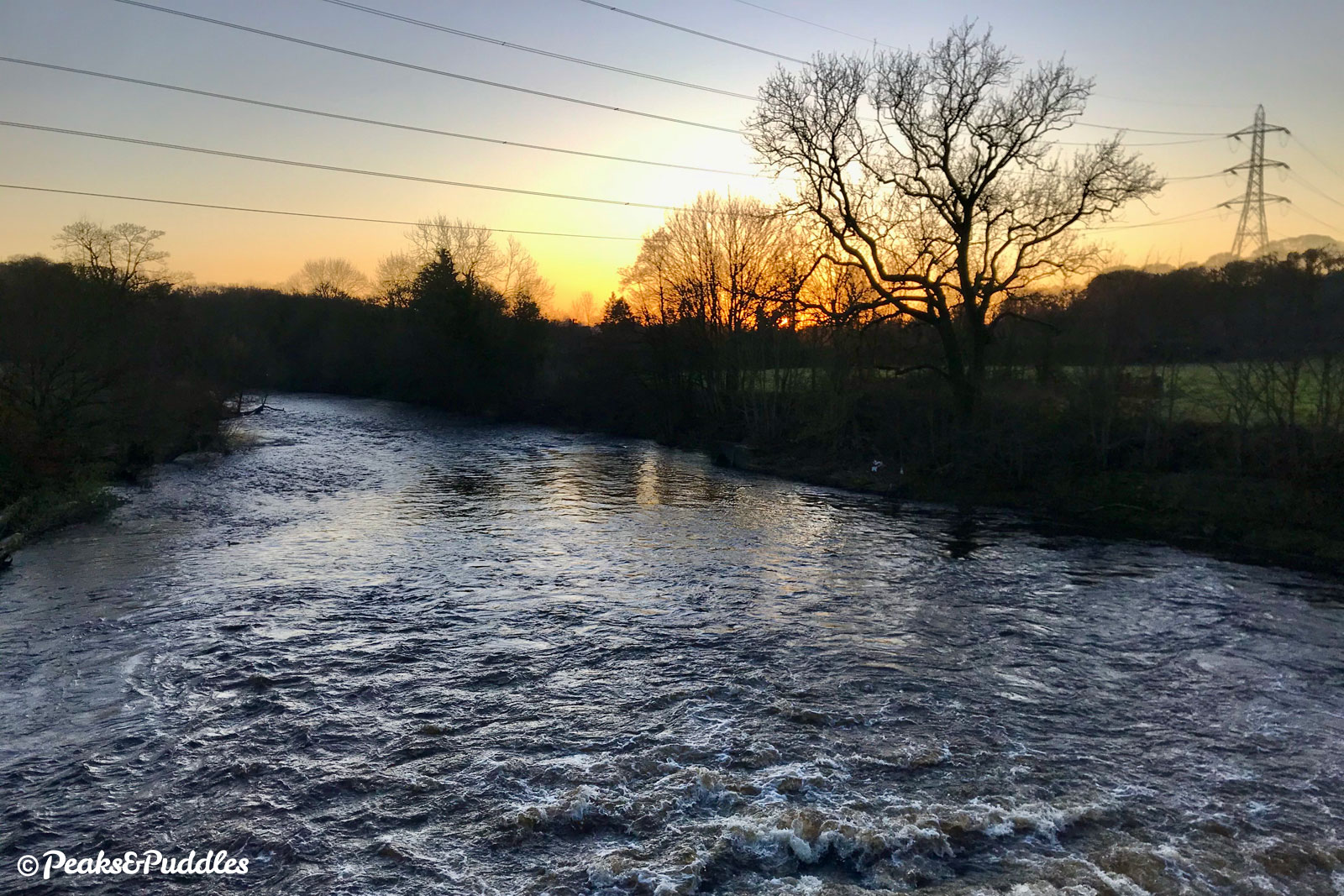 A raging winter evening over the River Goyt, almost unrecognisable from its meagre start near Whaley Bridge.