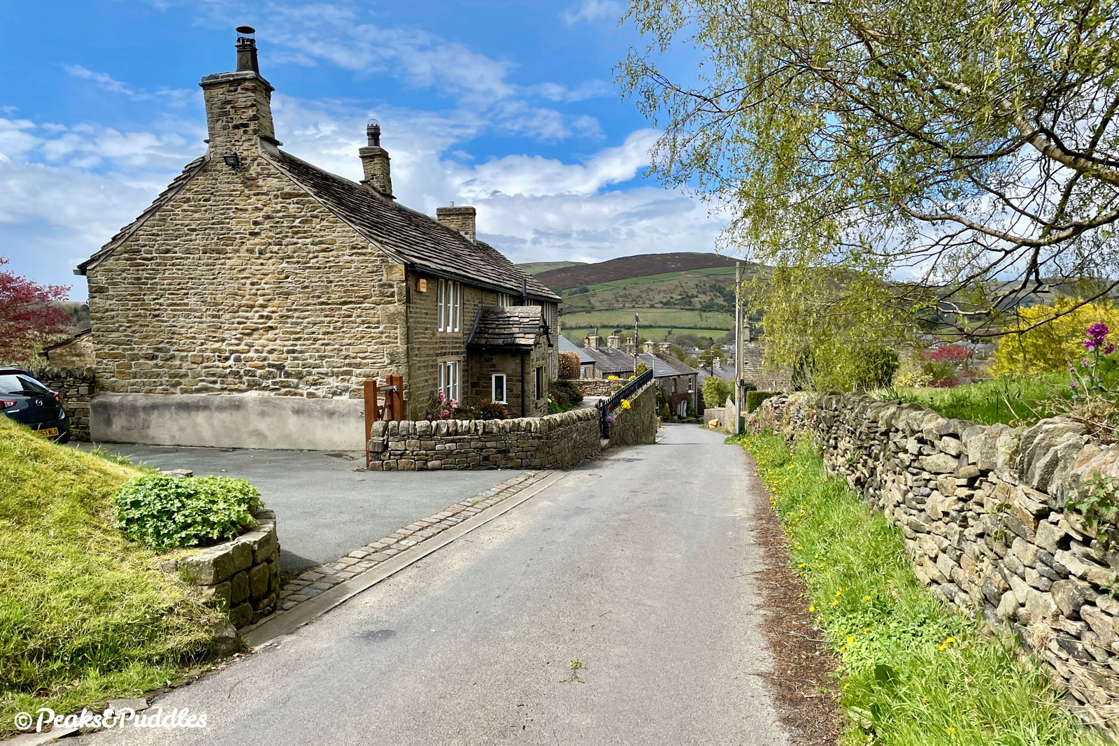 A particularly picturesque view back to Hayfield, a village of big hills and beautiful gritstone cottages.