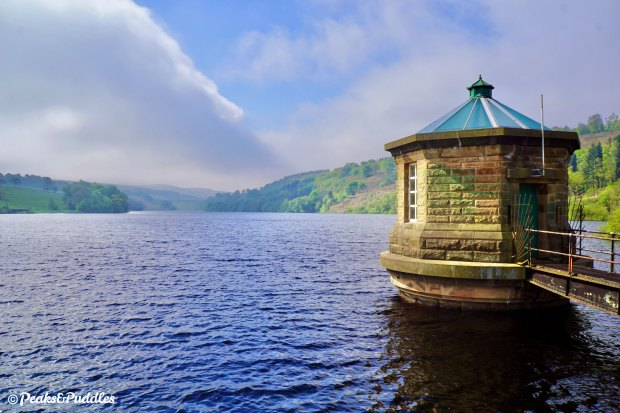 The octagonal valve tower looks out over the mile-long expanse of Fernilee Reservoir, the dam of Errwood Reservoir just visible.