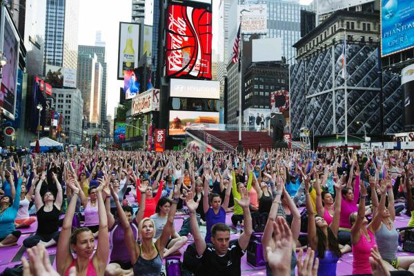 People take part in a group yoga practice on the morning of the summer solstice in New York's Times Square