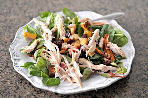 Whole30 compliant salad with chicken and roasted root vegetables.