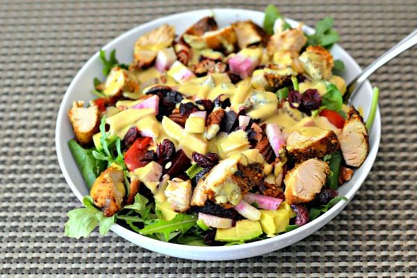 Salad topped with homemade tahini turmeric dressing.